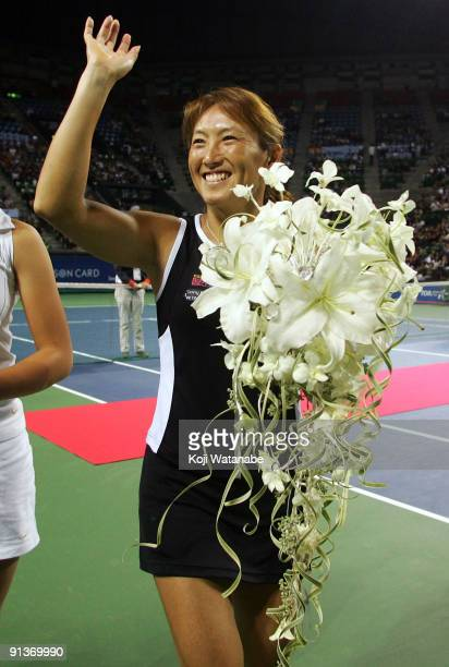 TOKYO OCTOBER 03 Ai Sugiyama of Japan smiles during a ceremony on day seven of the Toray Pan Pacific Open Tennis tournament at Ariake Colosseum on...
