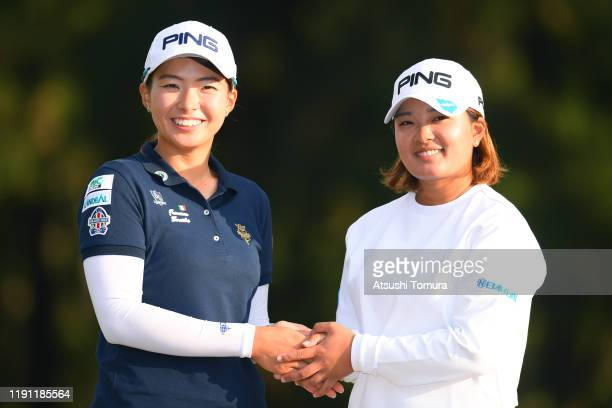 Ai Suzuki and Hinako Shibuno of Japan shake hands after the final round of the LPGA Tour Championship Ricoh Cup at Miyazaki Country Club on December...