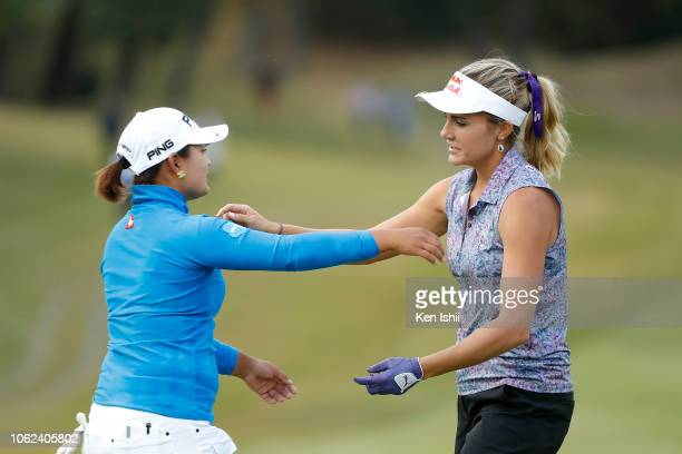 Ai Suzuki of Japan and Lexi Thompson of United States hug on the 18th green during the first round of the TOTO Japan Classic at Seta Golf Course on...