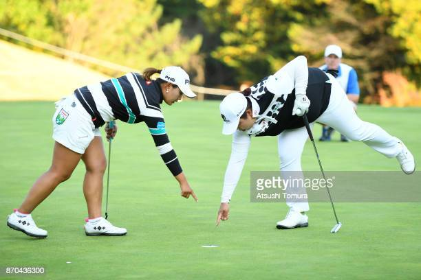 Ai Suzuki of Japan and Shanshan Feng of China on the 17th green during the final round of the TOTO Japan Classics 2017 at the Taiheiyo Club Minori...