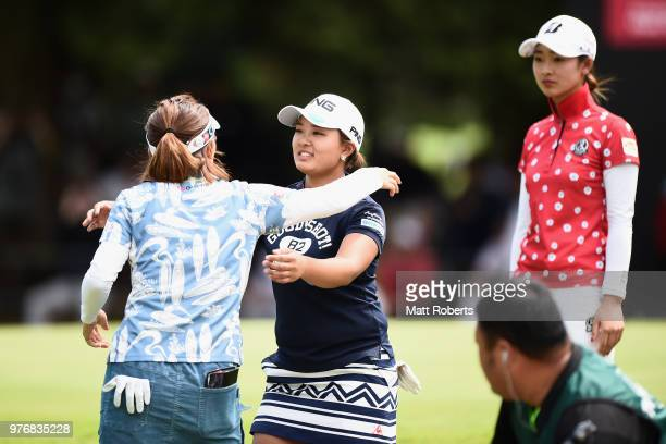 Ai Suzuki of Japan and Teresa Lu of Taiwan hug on the 18th green during the final round of the Nichirei Ladies at the Sodegaura Country Club Shinsode...