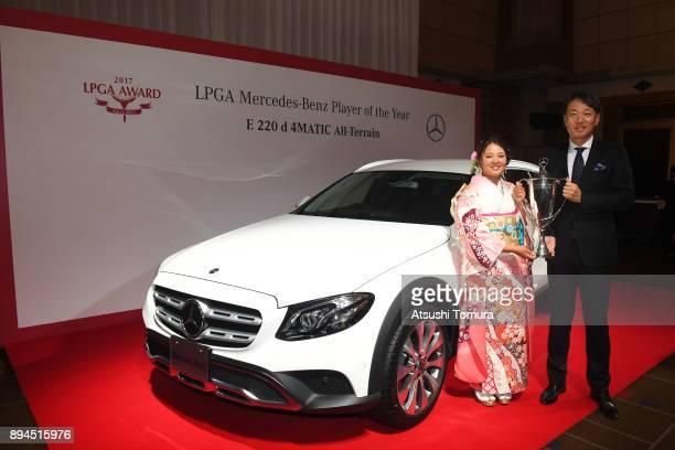 Ai Suzuki of Japan and the representative Director President CEO of MercedesBenz Japan Kintaro Ueno pose with the prize car during the LPGA Awards...
