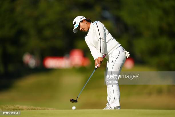 Ai Suzuki of Japan attempts a putt on the 17th green during the final round of the JLPGA Tour Championship Ricoh Cup at the Miyazaki Country Club on...