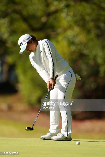 Ai Suzuki of Japan attempts a putt on the 1st green during the final round of the JLPGA Tour Championship Ricoh Cup at the Miyazaki Country Club on...