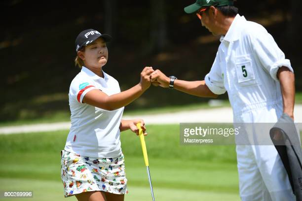 Ai Suzuki of Japan celebrates after making her birdie putt on the 7th hole during the third round of the Earth Mondamin Cup at the Camellia Hills...
