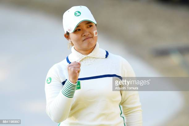 Ai Suzuki of Japan celebrates after making her birdie putt on the 17th hole during the second round of the Queens at Miyoshi Country Club on December...