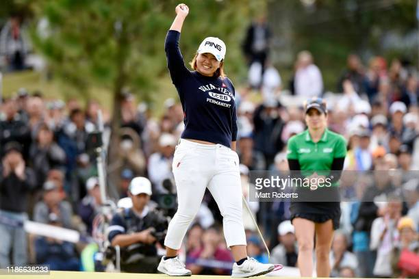 Ai Suzuki of Japan celebrates winning the tournament on the 18th green during the final round of the TOTO Japan Classic at Seta Golf Course North...