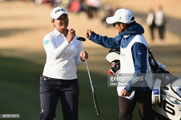 Ai Suzuki of Japan celebrates with her caddie on the 18th green during the second round of the TPoint Ladies Golf Tournament at the Ibaraki Kokusai...