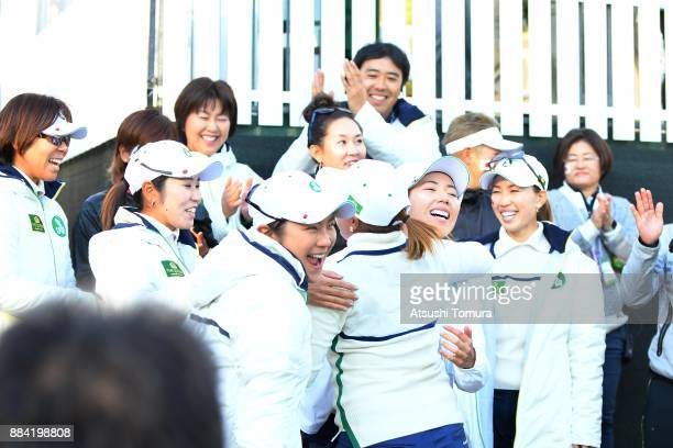 Ai Suzuki of Japan celebrates with her team mates after winning the match against SeonWoo Bae of South Korea during the second round of the Queens at...