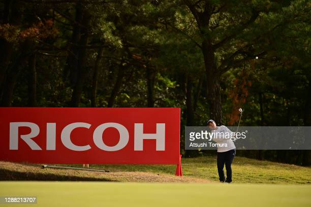 Ai Suzuki of Japan chips onto the 13th green during the third round of the JLPGA Tour Championship Ricoh Cup at the Miyazaki Country Club on November...
