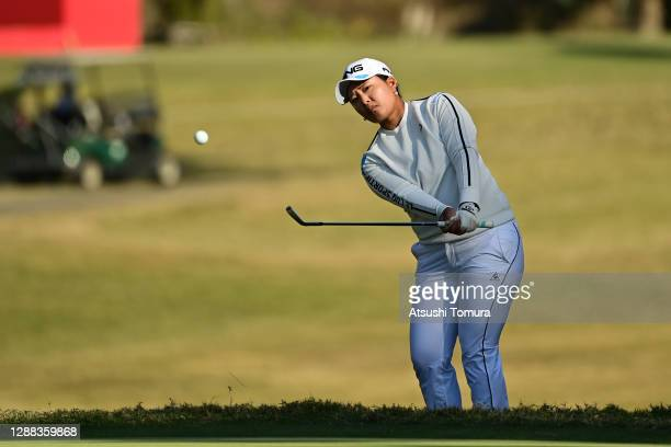 Ai Suzuki of Japan chips onto the 18th green during the final round of the JLPGA Tour Championship Ricoh Cup at the Miyazaki Country Club on November...