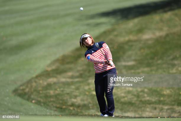 Ai Suzuki of Japan chips onto the 1st green during the first round of the CyberAgent Ladies Golf Tournament at the Grand Fields Country Club on April...