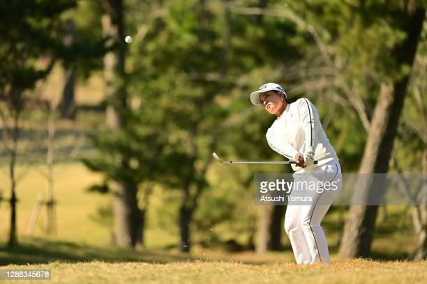 Ai Suzuki of Japan chips onto the 5th green during the final round of the JLPGA Tour Championship Ricoh Cup at the Miyazaki Country Club on November...