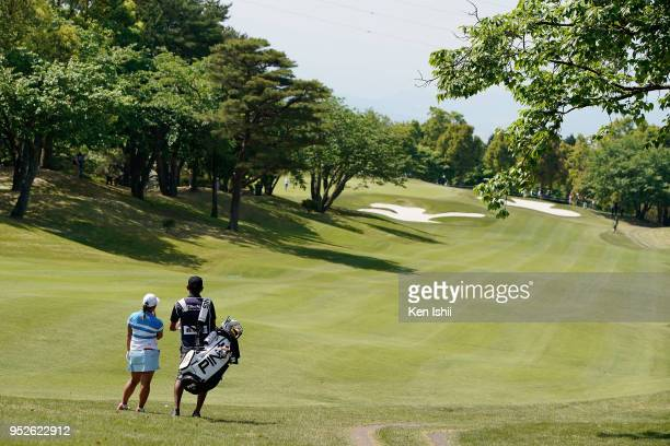Ai Suzuki of Japan hits a second shot on the first hole during the final round of the CyberAgent Ladies Golf Tournament at Grand fields Country Club...
