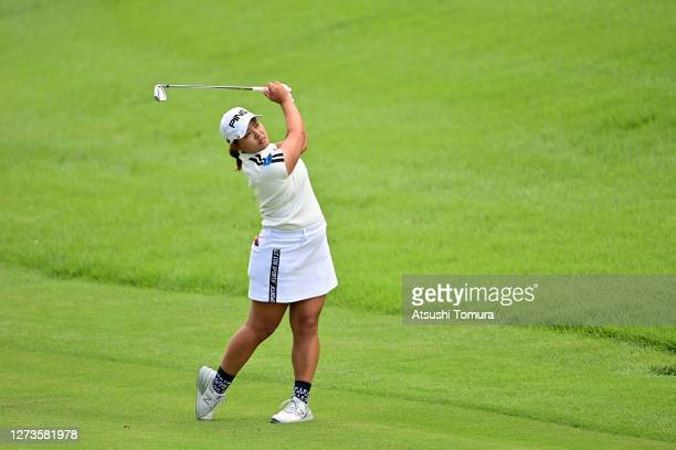 Ai Suzuki of Japan hits her second shot on the 14th hole during the final round of the Descente Ladies Tokai Classic at the Shin Minami Aichi Country...