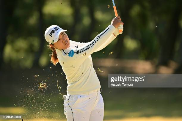 Ai Suzuki of Japan hits her second shot on the 14th hole during the final round of the JLPGA Tour Championship Ricoh Cup at the Miyazaki Country Club...