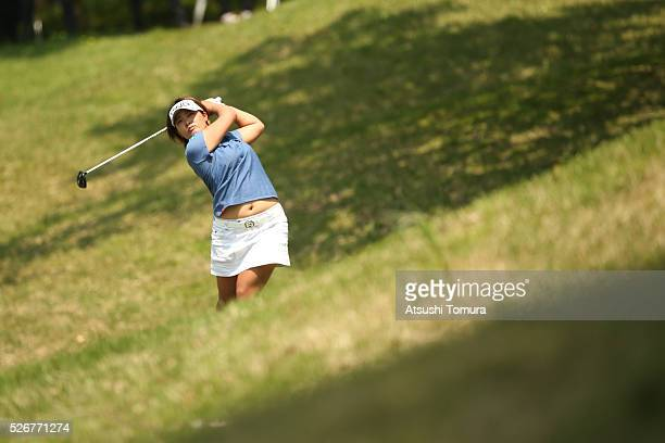 Ai Suzuki of Japan hits her second shot on the 14th hole during the final round of the CyberAgent Ladies Golf Tournament at the Grand Fields Country...