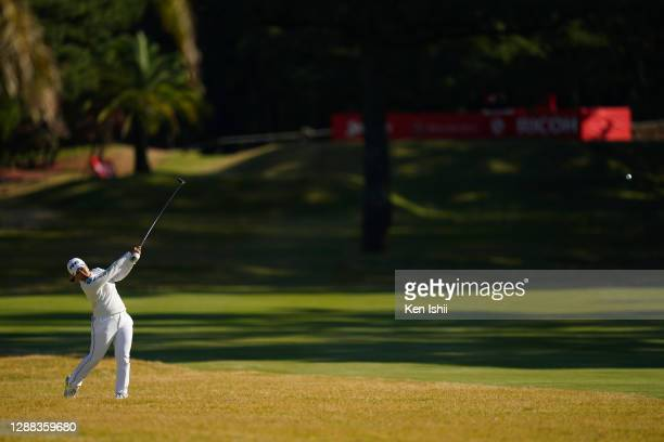 Ai Suzuki of Japan hits her second shot on the 18th hole during the final round of the JLPGA Tour Championship Ricoh Cup at the Miyazaki Country Club...