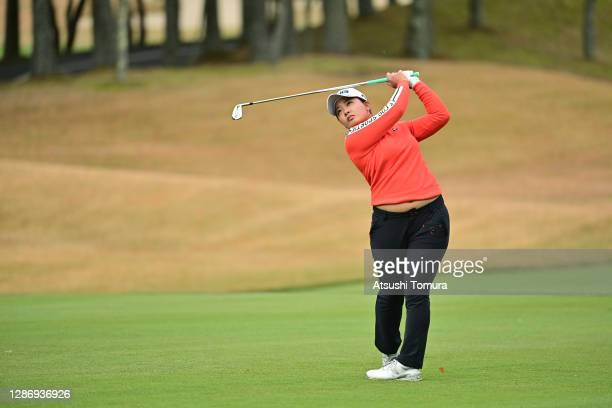 Ai Suzuki of Japan hits her second shot on the 1st hole during the final round of the Daio Paper Elleair Ladies Open at the Elleair Golf Club...