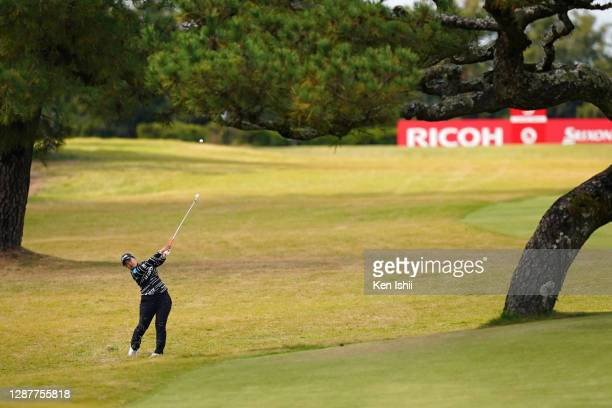 Ai Suzuki of Japan hits her second shot on the 3rd hole during the first round of the JLPGA Tour Championship Ricoh Cup at the Miyazaki Country Club...
