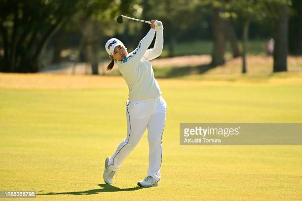 Ai Suzuki of Japan hits her second shot on the 7th hole during the final round of the JLPGA Tour Championship Ricoh Cup at the Miyazaki Country Club...