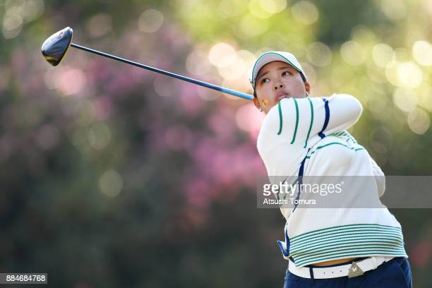 Ai Suzuki of Japan hits her tee shot on the 7th hole during the third round of the Queens at Miyoshi Country Club on December 3 2017 in Miyoshi Hyogo...