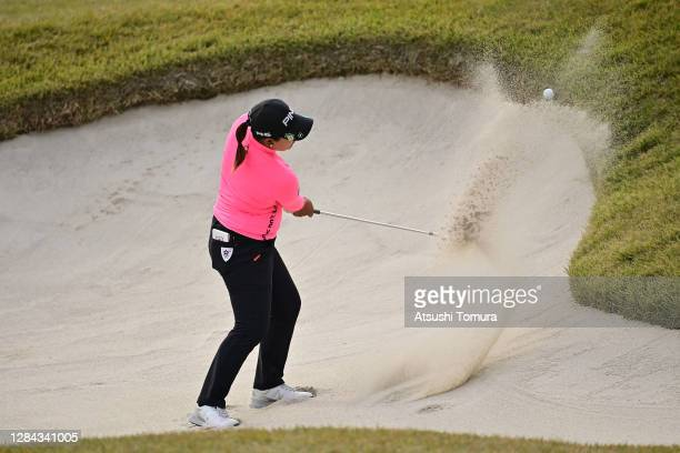 Ai Suzuki of Japan hits out from a bunker on the 17th hole during the second round of the TOTO Japan Classic at the Taiheiyo Club Minori Course on...