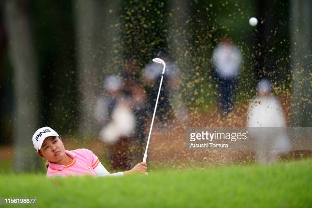 Ai Suzuki of Japan hits out from a bunker on the 5th hole during the final round of the Ai Miyazato Suntory Ladies Open Golf Tournament at Rokko...