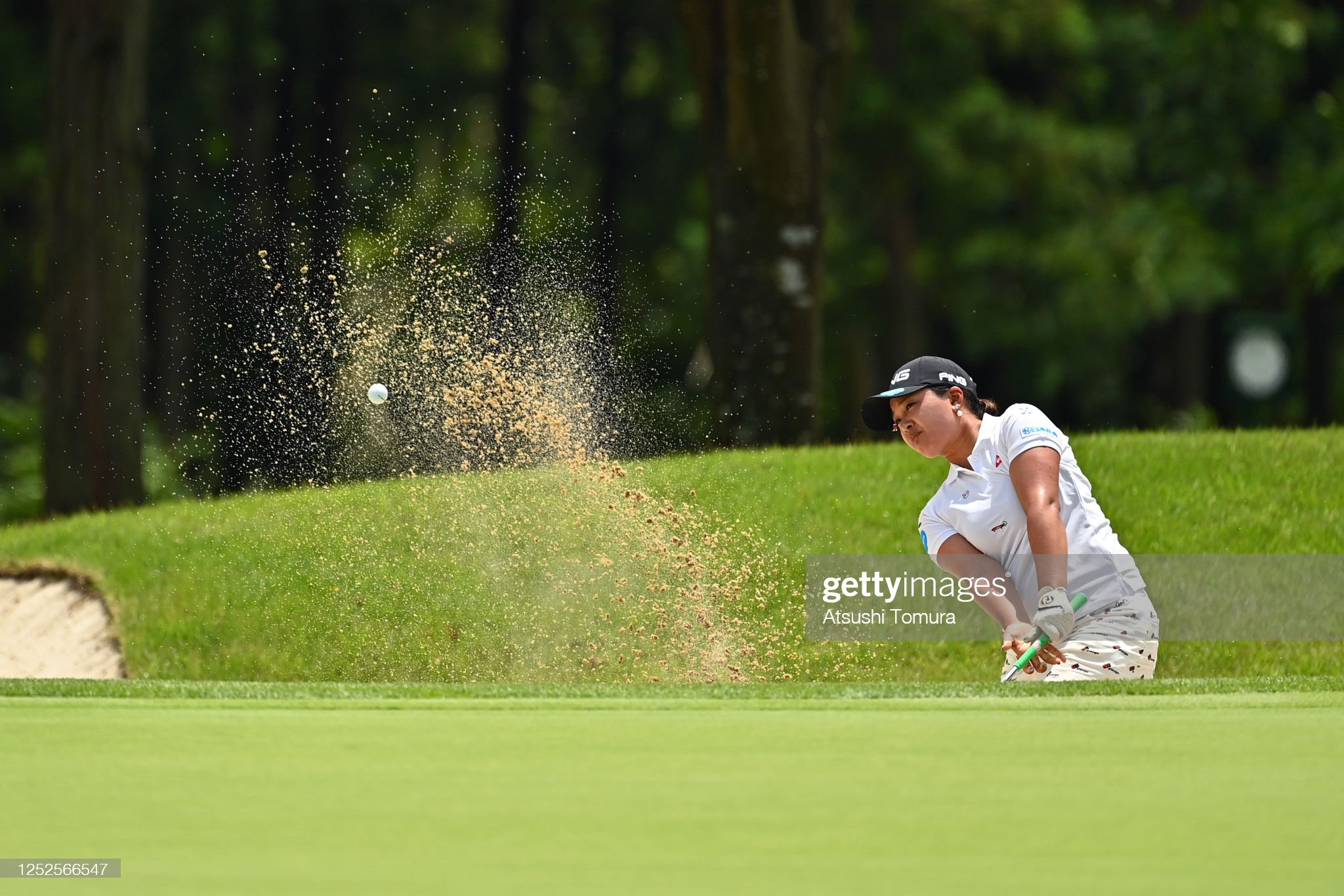 https://media.gettyimages.com/photos/ai-suzuki-of-japan-hits-out-from-a-bunker-on-the-9th-hole-during-the-picture-id1252566547?s=2048x2048
