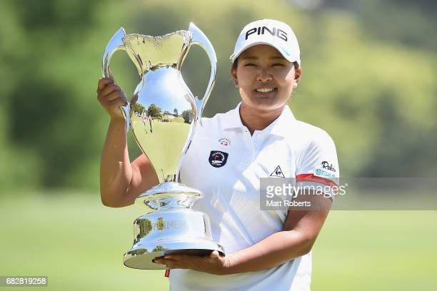 Ai Suzuki of Japan holds the winners trophy during the final round of the HokennoMadoguchi Ladies at the Fukuoka Country Club Wajiro Course on May 14...