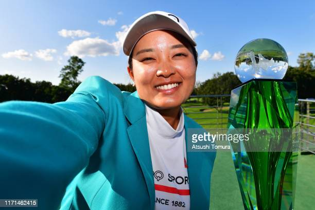 Ai Suzuki of Japan imitates a selfie after winning the tournament following the final round of the Nitori Ladies at Otaru Country Club on September 1...