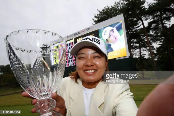Ai Suzuki of Japan imitates selfie photographs after winning the tournament following the final round of the Hisako Higuchi Mitsubishi Electric...