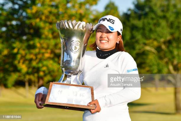 Ai Suzuki of Japan imitates selfie photographs after winning the tournament following the final round of the ItoEn Ladies at Great Island Club on...