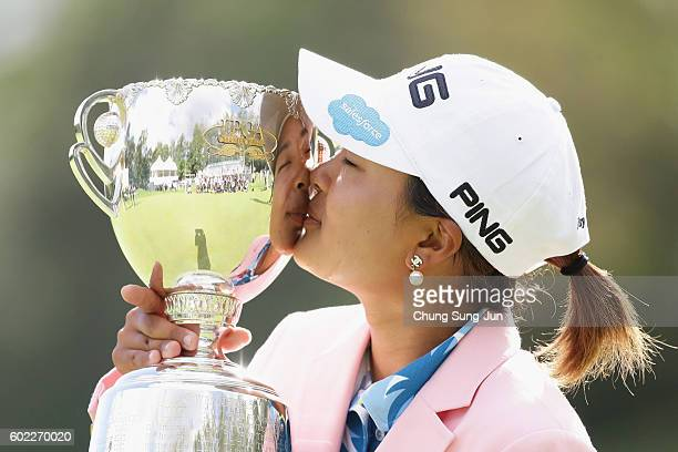 Ai Suzuki of Japan kisses the winner's trophy during a ceremony following the 49th LPGA Championship Konica Minolta Cup 2016 at the Noboribetsu...