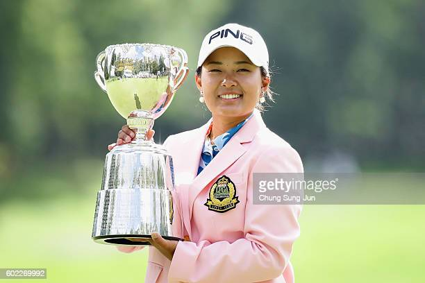 Ai Suzuki of Japan lifts winner's trophy during a ceremony following the 49th LPGA Championship Konica Minolta Cup 2016 at the Noboribetsu Country...