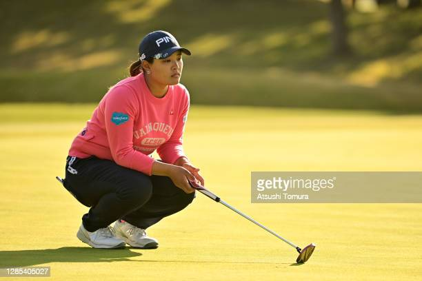 Ai Suzuki of Japan lines up a putt on the 15th green during the first round of the Ito-En Ladies Golf Tournament at the Great Island Club on November...