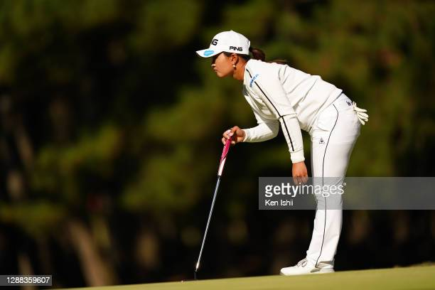 Ai Suzuki of Japan lines up a putt on the 17th green during the final round of the JLPGA Tour Championship Ricoh Cup at the Miyazaki Country Club on...