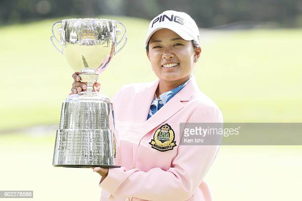 Ai Suzuki of Japan poses with her trophy on the 18th hole after winning the 49th LPGA Championship Konica Minolta Cup 2016 at the Noboribetsu Country...