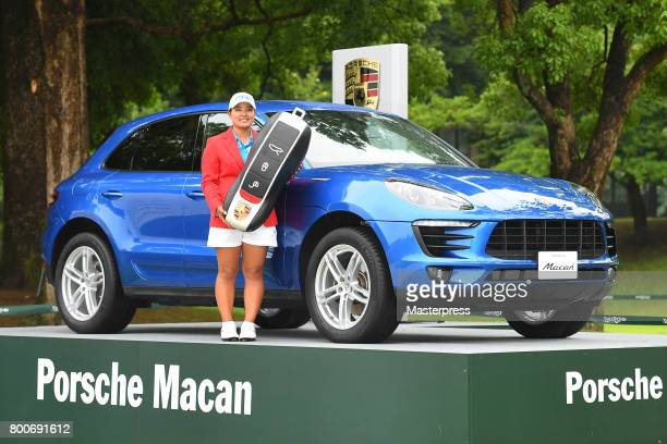 Ai Suzuki of Japan poses with the prize car after winning the Earth Mondamin Cup at the Camellia Hills Country Club on June 25 2017 in Sodegaura Japan
