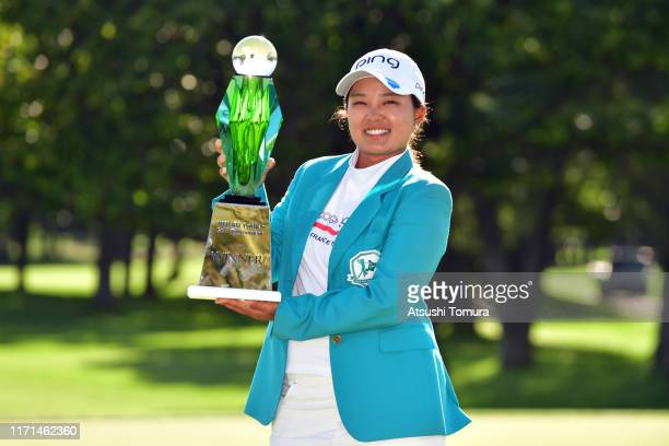 Ai Suzuki of Japan poses with the trophy after the award ceremony following the final round of the Nitori Ladies at Otaru Country Club on September 1...