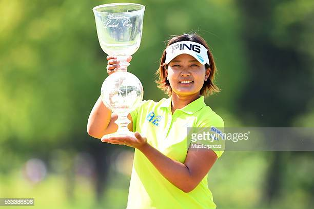Ai Suzuki of Japan poses with the trophy after winning the Chukyo Television Bridgestone Ladies Open at the Chukyo Golf Club Ishino Course on May 23...