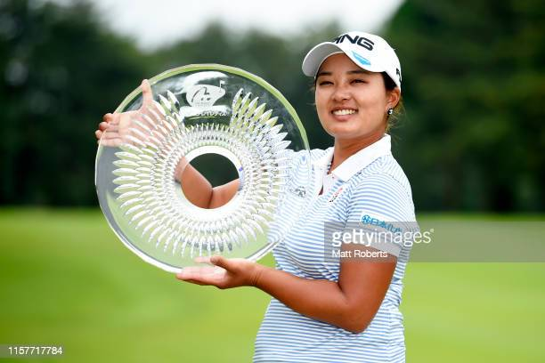 Ai Suzuki of Japan poses with the trophy after winning the tournament during the final round of the Nichirei Ladies at Sodegaura Country Club...