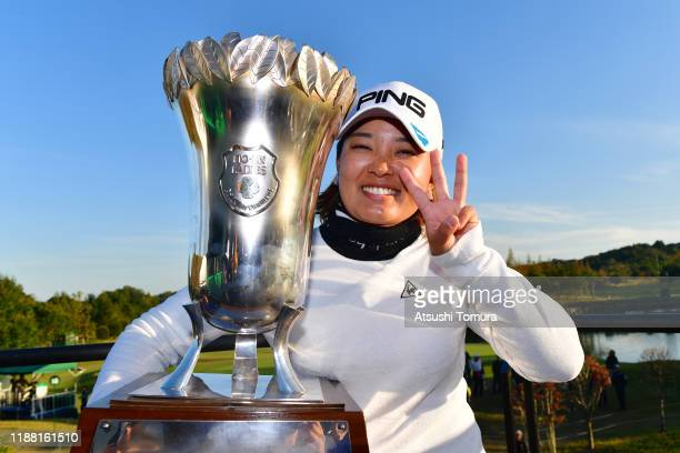 Ai Suzuki of Japan poses with the trophy after winning the tournament following the final round of the ItoEn Ladies at Great Island Club on November...