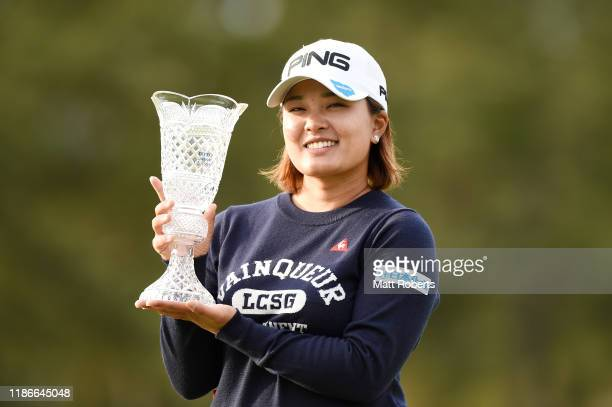 Ai Suzuki of Japan poses with the winners trophy after her 17 underpar victory during the final round of the TOTO Japan Classic at Seta Golf Course...