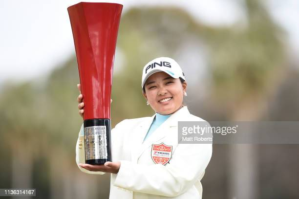 Ai Suzuki of Japan poses with the winners trophy during the final round of the Yokohama Tire Golf Tournament PRGR Ladies Cup at Tosa Country Club on...