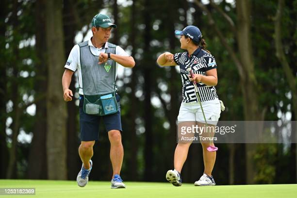 Ai Suzuki of Japan pretends to elbow bumps with caddie after the birdie on the 14th green during the final round of the Earth Mondamin Cup at the...