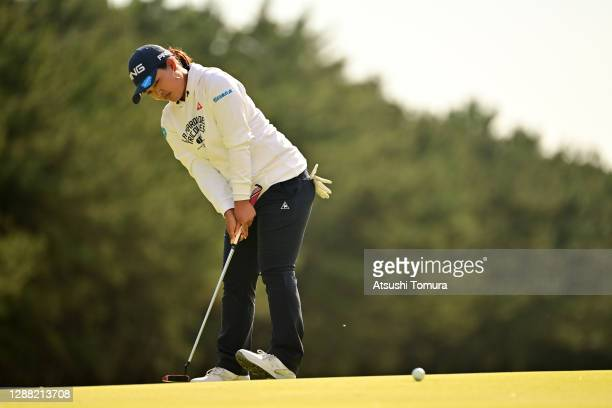 Ai Suzuki of Japan reacts after a putt on the 13th green during the third round of the JLPGA Tour Championship Ricoh Cup at the Miyazaki Country Club...