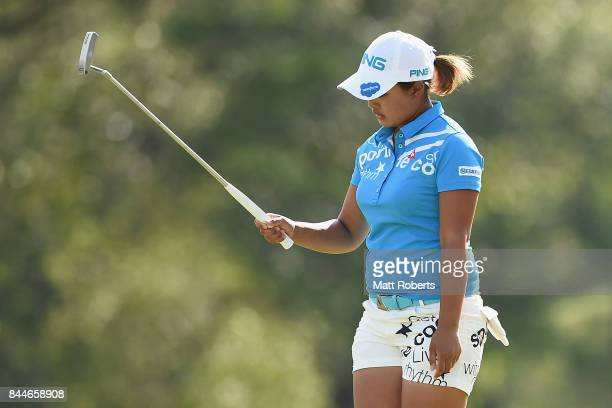 Ai Suzuki of Japan reacts after her putt on the 18th green during the third round of the 50th LPGA Championship Konica Minolta Cup 2017 at the Appi...