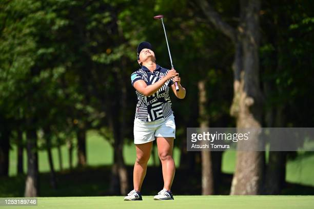 Ai Suzuki of Japan reacts after missing the birdie putt on the 18th green during the final round of the Earth Mondamin Cup at the Camellia Hills...