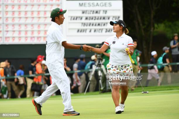 Ai Suzuki of Japan shake hands with her caddie after the third round of the Earth Mondamin Cup at the Camellia Hills Country Club on June 24 2017 in...